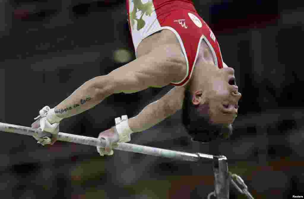 David Belyavsky of Russia competes on the horizontal bar. Russia returned to the podium for the first time since 2000 to take the silver medal in the men's gymnastics team competition, while Japan took the gold.