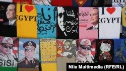 Египеттегі президент сайлауына түсіп жатқан үміткерлер жарнамасы жазылған билборд. Каир, 10 мамыр 2014 жыл.