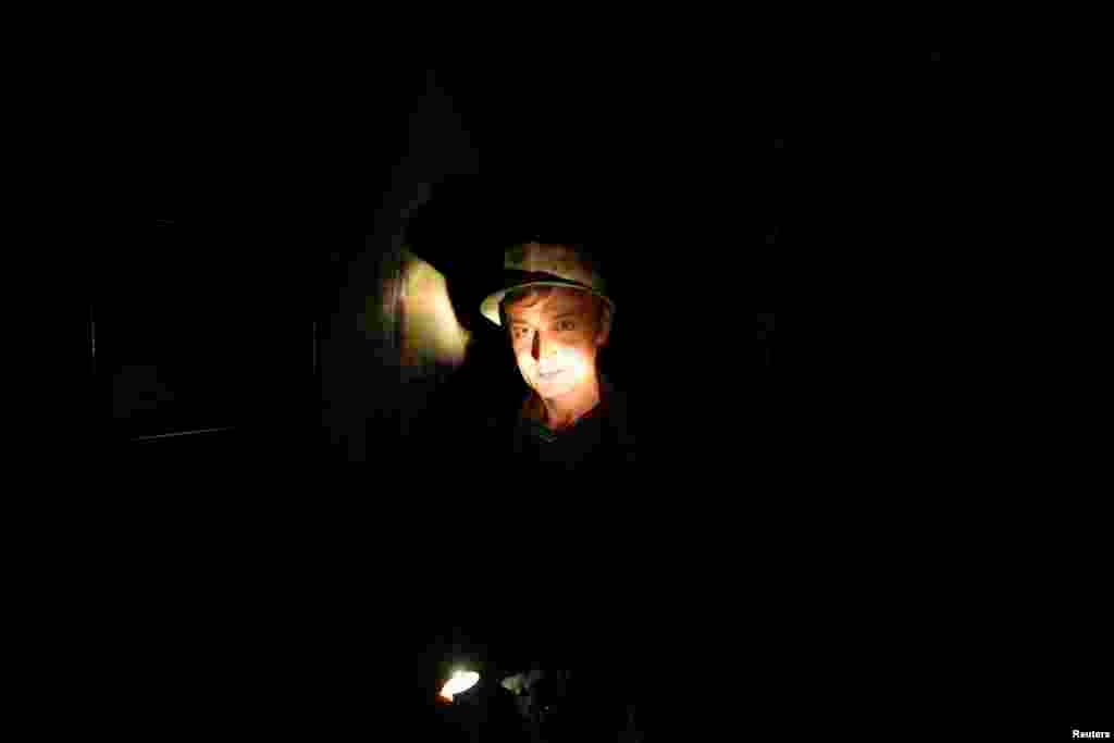 A miner descends into the copper mine.