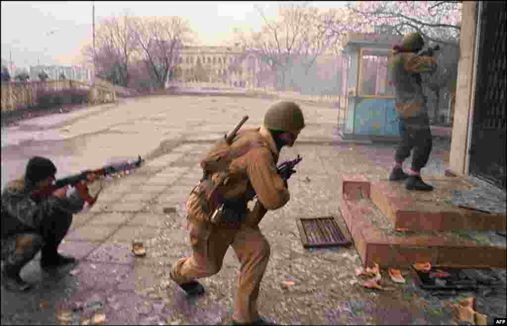 Chechen fighters engage in a street battle.