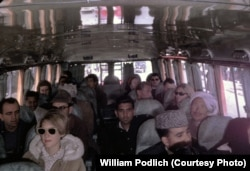 Peg Podlich (in sunglasses) during a family trip by bus from Kabul to Peshawar, Pakistan.