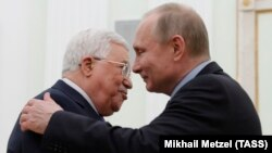Russian President Vladimir Putin (right) embraces Palestinian Authority President Mahmud Abbas during a meeting at the Kremlin in Moscow on February 12.