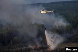 Гасіння минулої пожежі в зоні відчуження Чорнобильської АЕС. 28 квітня 2015 року