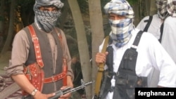 Militants of the Islamic Movement of Uzbekistan (IMU) pose for a photo in Afghanistan's northern Konduz Province.