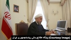 Hassan Rouhani signing a bill into law declaring all U.S. forces in the Middle East terrorists and calling the U.S. government a sponsor of terrorism. April 30, 2019