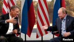 АҚШ пен Ресей президенттері Барак Обама (сол жақта) мен Владимир Путиннің кездесуі. Солтүстік Ирландия, 17 маусым 2013 жыл.
