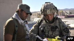 U.S. Staff Sergeant Robert Bales (left) at the National Training Center in Fort Irwin, California in a photo from August 2011
