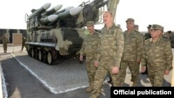 Azerbaijan - President Ilham Aliyev inspects weapons put on display at the site of exercises held by the Azerbaijani army, 26Jun2014.