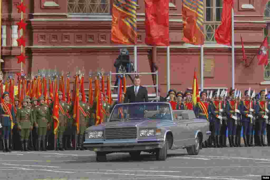 Russia - Acting defense minister Anatoly Serdyukov (C) riding an open-top ZIL limousine at a military parade in Red Square, 63rd anniversary Patriotic War, 09May2012