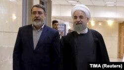 IRAN -- Iranian President Hassan Rohani (R) walks with Interior Minister Abdolreza Rahmani Fazli at the Interior Ministry in Tehran, December 21, 2015