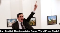Mevlut Mert Altintas shouts after shooting Andrei Karlov, the Russian ambassador to Turkey, at an art gallery in Ankara, Turkey, December 19, 2016.<br /> <br /> The winning World Press Photo Of The Year, from Burhan Ozbilici of Associated Press, was also part of a series, &quot;An Assassination in Turkey&quot;, which won the Spot News - Stories category. Ozbilici captured the moments before and after Altintas, an off-duty policeman, drew a handgun and shot Karlov at a photo exhibition.<br /> <br /> &nbsp;