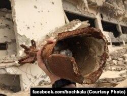 Маалула, залишки снаряду і зруйнований будинок