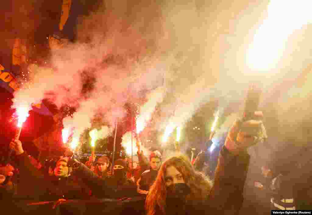 Activists of Ukrainian nationalist parties hold flares as they take part in a rally to mark the 109th anniversary of the birth of Stepan Bandera, one of the founders of the Organization of Ukrainian Nationalists (OUN), in Kyiv, on January 1. (Reuters/Valentyn Ogirenko)
