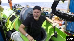 "U.S. film director James Cameron emerges from ""Deepsea Challenger"" after journeying to the bottom of the Pacific Ocean in March."
