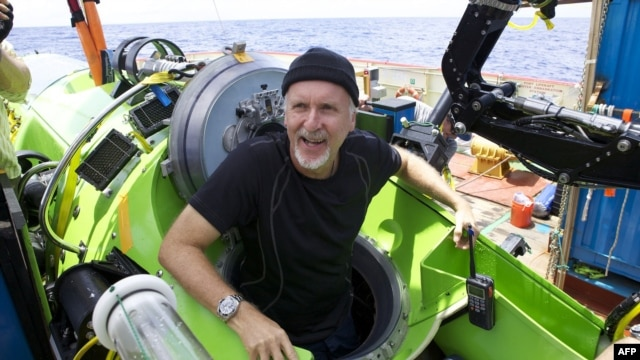 """U.S. film director James Cameron emerges from """"Deepsea Challenger"""" after journeying to the bottom of the Pacific Ocean in March."""