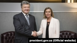 Ukrainian President Petro Poroshenko with EU foreign policy chief Federica Mogherini on March 12 in Kyiv.