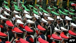 IRGC troops march during celebrations on Tehran's Azadi Square to mark the 37th anniversary of the Islamic Revolution in February 2016.
