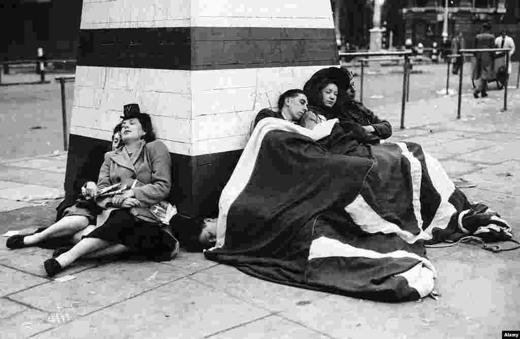 Revellers sleeping off the giant victory party. Although the war in Europe was over, the Second World War was not. The fight against Japan continued until September 1945.