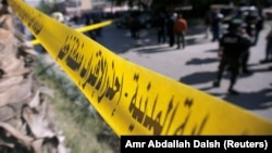 Egypt - Security officials and investigators inspect the scene of a bomb blast in Giza Al Haram