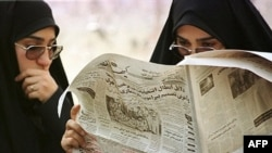 "Iranian women read the conservative newspaper ""Kayhan"" in Tehran."