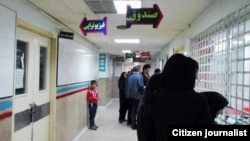 People standing in front of a cashier's window at a hospital in Iran, undated. FILE PHOTO
