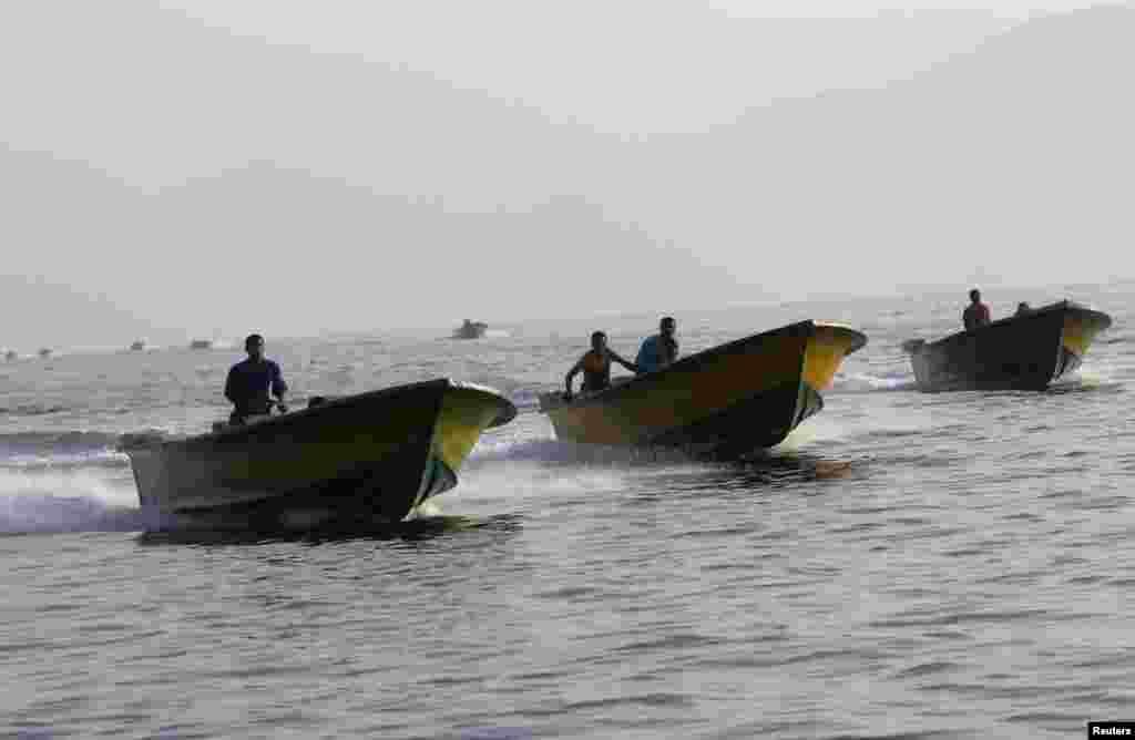 Oman - Iranian smugglers drive their boats near the Omani port of Khasab, 26 Sep 2012.