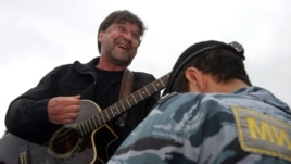 Russian rock singer Yury Shevchuk performs at a protest rally in central Moscow.