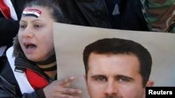 Pristalice al Asada na protestu u Damasku
