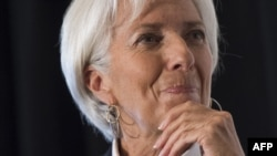 IMF Managing Director Christine Lagarde says she is concerned about corruption alleged by a Ukrainian economy minister who resigned.