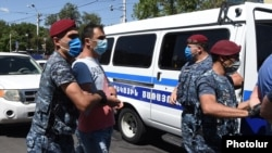 Armenia -- Police detain supporters of Prosperous Armenia Party leader Gagik Tsarukian, Yerevan, June 14, 2020.