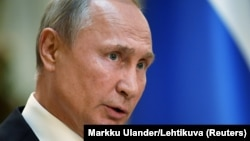 "Russian President Vladimir Putin said Russia will not be drawn into a ""costly"" new arms race. (file photo)"