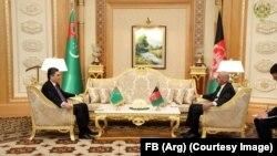 Afghan President Ashraf Ghani (R) with Turkmen President Gurbanguly Berdymukhammedov in Astana on February 21.