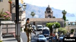 A military guard stands watch at the Group of Seven (G7) in Taormina, Sicily May 26, 2017