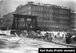 A group of horses being rescued after a bridge collapsed into the icy water of a St. Petersburg canal.