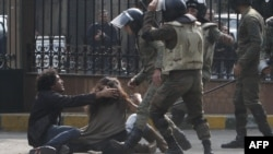 Soldiers beat up protesters near Cairo's Tahrir Square on December 16.