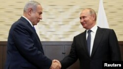 Russian President Vladimir Putin (rigth) shakes hands with Israeli Prime Minister Benjamin Netanyahu in Sochi on September 12.