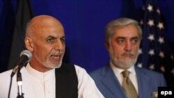 Afghan Presidential Contenders Abdullah Abdullah (R) and Ashraf Ghani