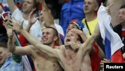 Russian soccer fans celebrating during their country's 4-1 win over the Czech Republic in Wroclaw, Poland.
