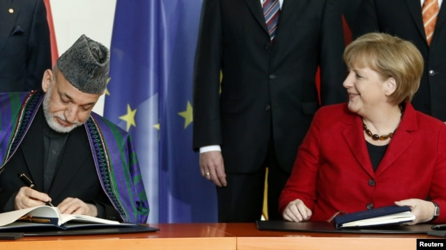 German Chancellor Angela Merkel (right) with Afghan President Hamid Karzai in Berlin.