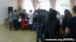 Students line up to vote early at a polling station in Vitsebsk on September 22.