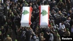 Генерал Висам әл-Хасан мен оның оққағарын жерлеу рәсіміне жиналғандар. Ливан, Бейрут, 21 қазан 2012 жыл.