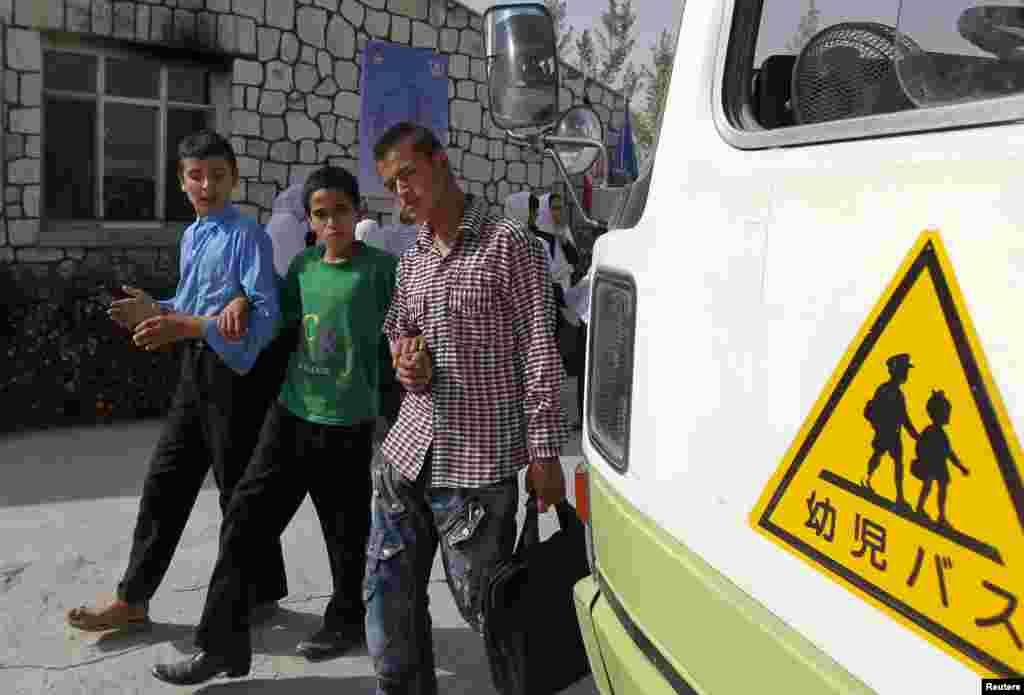 Blind students leave the Kabul Blind School.