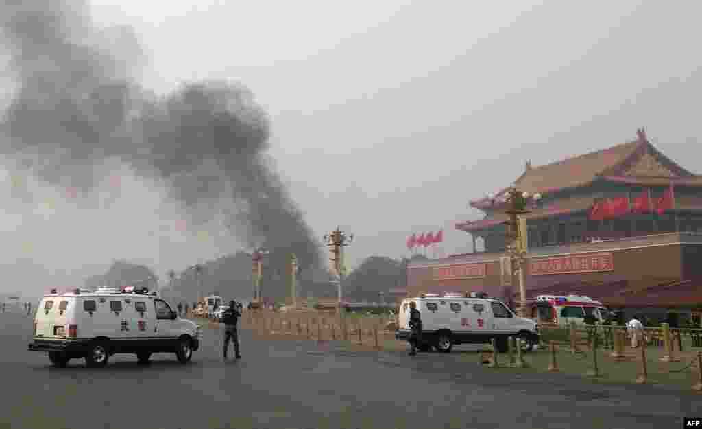 Police cars block off roads around Tiananmen Square in Beijing after a deadly incident at one of China's most-visited sites in which a car crashed into a crowd, killing several people and injuring dozens more.