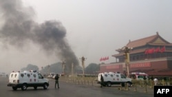 Police cars block off roads around Tiananmen Square in Beijing after the deadly car crash on October 28.