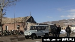 Armenia -- A police car patrols Charchakis village to prevent further election-related violence, 12Jan2010.