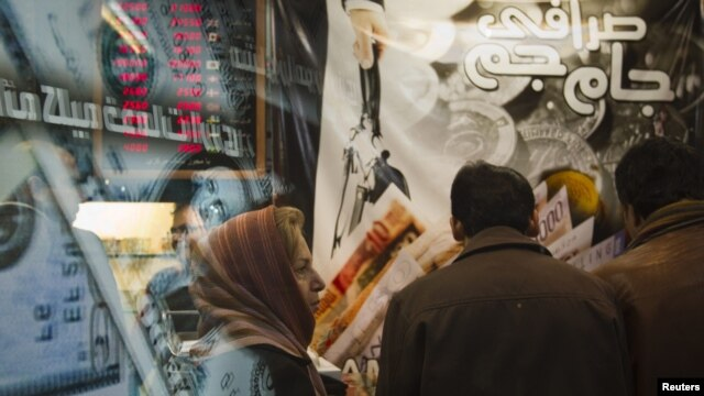 A woman stands in a currency exchange shop in northern Tehran on January 3.