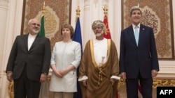 U.S. Secretary of State John Kerry (right),EU adviser Catherine Ashton (second left), Iranian Foreign Minister Javad Zarif (left) and Omani Minister Responsible for Foreign Affairs Yussef bin Alawi (second right) pose for a photo in Muscat on November 9.