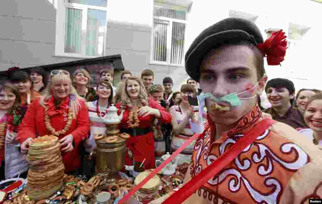 Students of a medical academy celebrate Maslenitsa, or Pancake Week, in the southern Russian city of Stavropol. Maslenitsa is widely viewed as a pagan holiday marking the end of winter and is celebrated with pancake eating, while the Orthodox Church considers it as the week of feasting before Lent. (Reuters/Eduard Korniyenko)