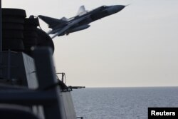 A Russian Sukhoi Su-24 attack aircraft made a close flyby to a U.S. guided-missile destroyer in the Baltic Sea last month.