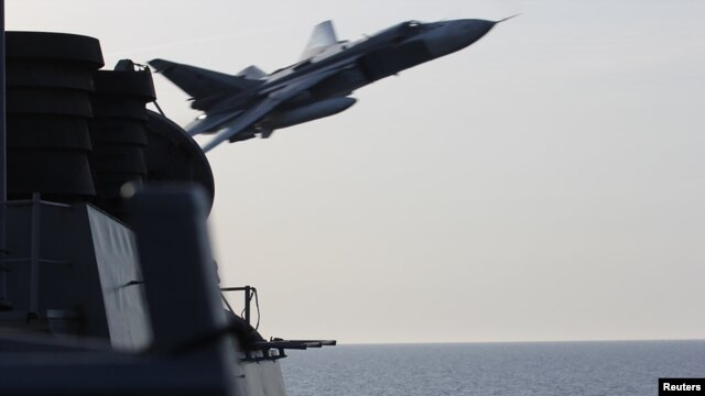 A Russian Su-24 attack aircraft buzzes a U.S. destroyer in the Baltic Sea on April 12.